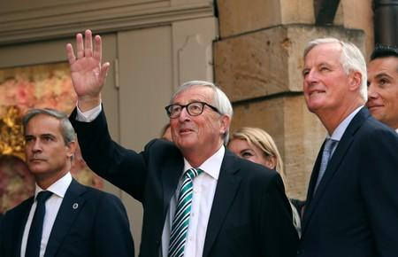 EC President Juncker waves as he arrives with EU chief Brexit negotiator Barnier in Luxembourg