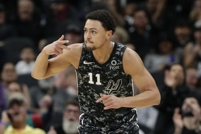 San Antonio Spurs guard Bryn Forbes (11) reacts after a score against the Atlanta Hawks during the first half of an NBA basketball game in San Antonio, Friday, Jan. 17, 2020. (AP Photo/Eric Gay)
