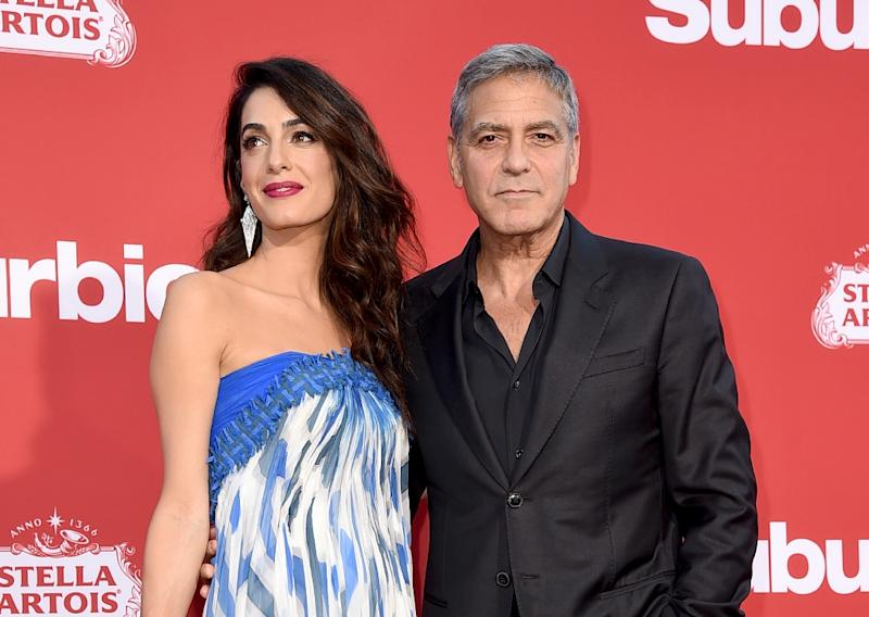 """George Clooney and his wife Amal, shown in this October 22, 2017 file photo, said they have been inspired by the """"courage and eloquence"""" of the survivors of the latest US school shooting"""