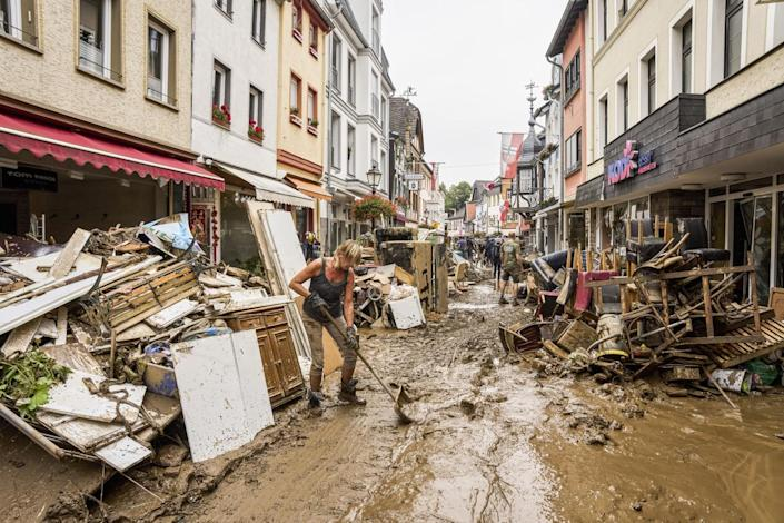 Residents and shopkeepers trying to clear mud