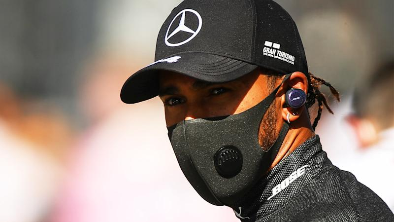 Lewis Hamilton (pictured) wearing a mask during the F1.