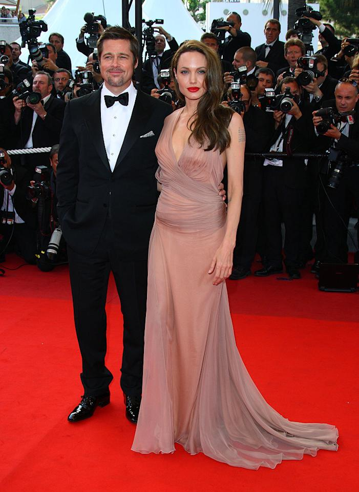 """8. 62nd Annual Cannes Film Festival <a href=""""http://movies.yahoo.com/movie/1808404206/info"""">Inglourious Basterds</a> screening (2009)   Mr. Pitt looked positively handsome in his Tom Ford tux, but it was Angelina who stole the spotlight in the South of France thanks to her glamorous chiffon Versace gown, caramel-colored coif, and signature smirk."""