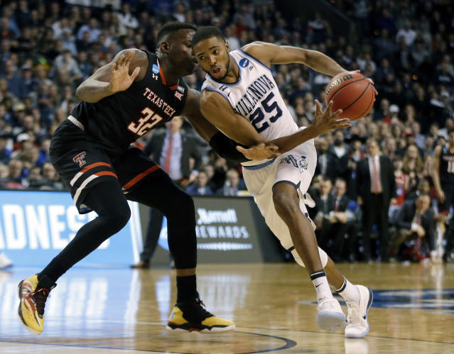 Villanova's Mikal Bridges (right) tries to drive past Texas Tech's Norense Odiase during the Wildcats' East Regional victory. (AP)