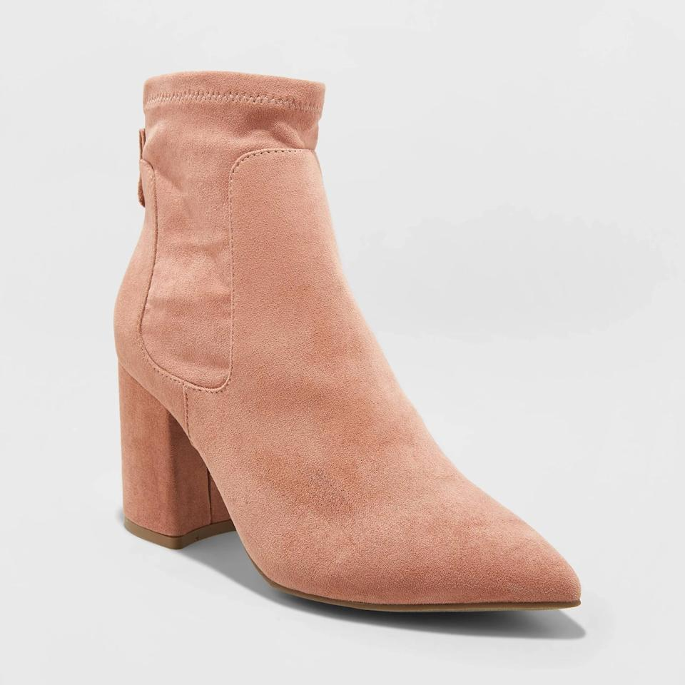 """<p>These blush <a href=""""https://www.popsugar.com/buy/New-Day-Women-Cornelia-Microsuede-Pointed-Sock-Booties-498509?p_name=A%20New%20Day%20Women%27s%20Cornelia%20Microsuede%20Pointed%20Sock%20Booties&retailer=target.com&pid=498509&price=38&evar1=fab%3Aus&evar9=46721262&evar98=https%3A%2F%2Fwww.popsugar.com%2Ffashion%2Fphoto-gallery%2F46721262%2Fimage%2F46721468%2FNew-Day-Women-Cornelia-Microsuede-Pointed-Sock-Booties&list1=shopping%2Cfall%20fashion%2Ctarget%2Cshoes%2Cfall%2Cfall%20shoes%2Caffordable%20shopping&prop13=api&pdata=1"""" rel=""""nofollow"""" data-shoppable-link=""""1"""" target=""""_blank"""" class=""""ga-track"""" data-ga-category=""""Related"""" data-ga-label=""""https://www.target.com/p/women-s-cornelia-microsuede-pointed-sock-bootie-a-new-day-153/-/A-54479950?preselect=54437580#lnk=sametab"""" data-ga-action=""""In-Line Links"""">A New Day Women's Cornelia Microsuede Pointed Sock Booties</a> ($38) also come in cognac and black.</p>"""
