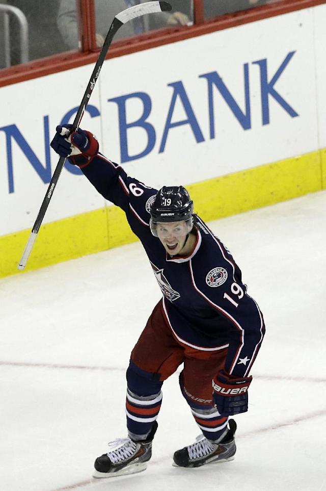 Columbus Blue Jackets' Ryan Johansen (19) celebrates his game winning goal against the Carolina Hurricanes during overtime of an NHL hockey game in Raleigh, N.C., Saturday, March 29, 2014. Columbus won 3-2. (AP Photo/Gerry Broome)