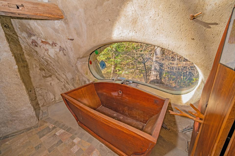 The cherry wood bath is a stunning feature. (SWNS)