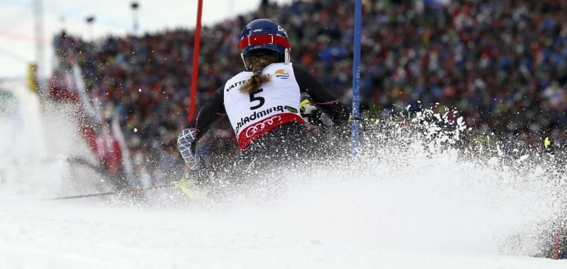 United States' Mikaela Shiffrin clears a gate during the second run of the women's slalom, at the Alpine skiing world championships in Schladming, Austria, Saturday, Feb.16, 2013. American teenager Mikaela Shiffrin became the youngest women's slalom world champion in 39 years on Saturday. (AP Photo/Alessandro Trovati)