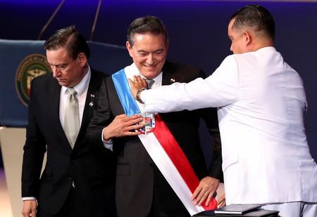 Panama's new President Laurentino Cortizo receives the presidential sash from the President of the National Assembly Marcos Castillero during his inauguration ceremony, in Panama City