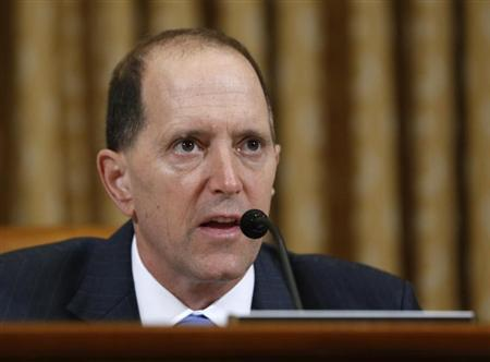 U.S. House Ways and Means Committee Chairman Camp questions outgoing acting IRS Commissioner Miller during a hearing on the Internal Revenue Service targeting conservative groups on Capitol Hill in Washington