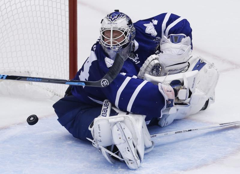 Toronto Maple Leafs' James Reimer lets in a goal by the Ottawa Senators during second-period action of an NHL hockey game in Toronto, Saturday, Oct. 5, 2013. (AP photo/The Canadian Press, Mark Blinch)