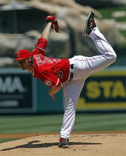 Los Angeles Angels starter C.J. Wilson pitches to the Chicago White Sox on the first inning of a baseball game in Anaheim, Calif., Thursday, May 17, 2012. (AP Photo/Reed Saxon)