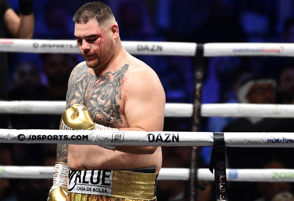 """Mexican-American boxer Andy Ruiz Jr returns to his corner during the heavyweight boxing match between Andy Ruiz Jr. and Anthony Joshua for the IBF, WBA and WBO titles in Diriya, near the Saudi capital on December 7, 2019. - Ruiz seeks to win back the titles that he lost to Ruiz in a shock June defeat in New York in this high-profile duel , dubbed """"Clash on the Dunes"""". (Photo by Fayez Nureldine / AFP) (Photo by FAYEZ NURELDINE/AFP via Getty Images)"""