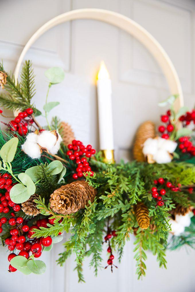 """<p>A traditional Christmas wreath with a distinctly Scandinavian vibe is easy to make. All you need is a few simple supplies, including an embroidery hoop, greenery, and a flameless candle. </p><p><em>Learn how at <a href=""""https://apumpkinandaprincess.com/diy-embroidery-hoop-christmas-wreath/"""" rel=""""nofollow noopener"""" target=""""_blank"""" data-ylk=""""slk:A Pumpkin and a Princess"""" class=""""link rapid-noclick-resp"""">A Pumpkin and a Princess</a>. </em> </p><p><a class=""""link rapid-noclick-resp"""" href=""""https://www.amazon.com/DROLE-Embroidery-Threading-50Colors-Embroidered/dp/B083W17N6Q?tag=syn-yahoo-20&ascsubtag=%5Bartid%7C10072.g.34454588%5Bsrc%7Cyahoo-us"""" rel=""""nofollow noopener"""" target=""""_blank"""" data-ylk=""""slk:SHOP EMBROIDERY HOOP"""">SHOP EMBROIDERY HOOP</a></p>"""