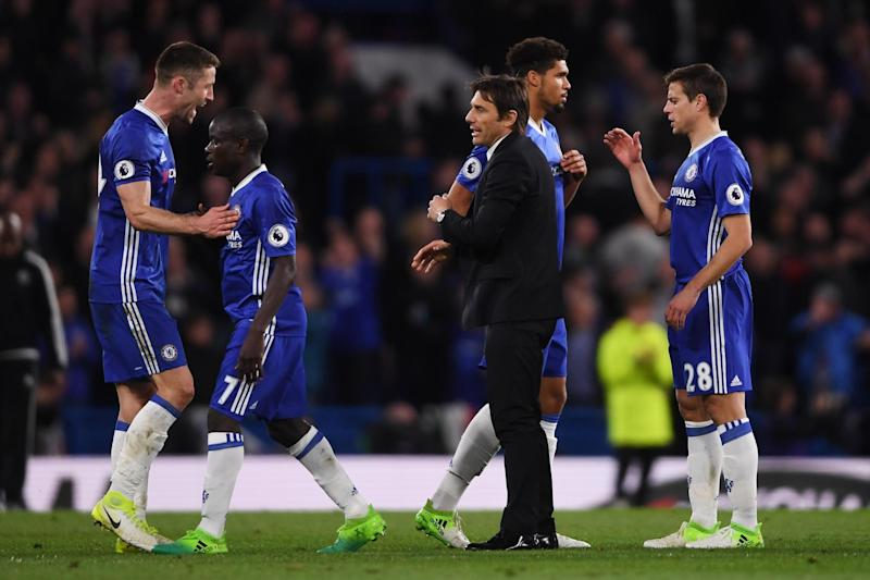 Happy squad: Chelsea lead the league by seven points: Getty Images