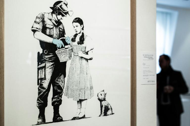 The dark wit of Banksy's art -- such as this work that went up for auction at the French auction house Artcurial in October -- has earned him an international following