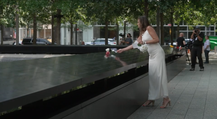 Monica Iken wore her wedding dress to the 9/11 Memorial in memory of her husband who was killed in the attacks. / Credit: CBS News