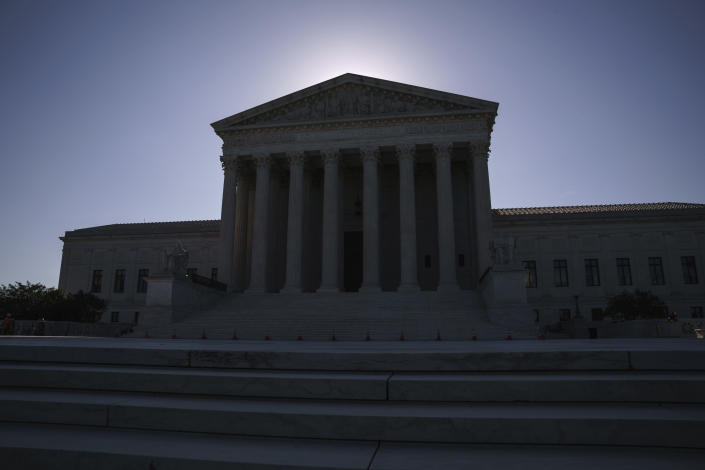 FILE - This June 29, 2021, file photo shows the U.S. Supreme Court on Capitol Hill in Washington. The Supreme Court is wrapping up its first all-virtual term, with decisions expected in a key case on voting rights and another involving information California requires charities to provide about donors. (AP Photo/J. Scott Applewhite, File)