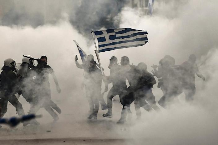 But the name deal has also unleashed angry protests in both Macedonia and Greece (AFP Photo/Aris MESSINIS)