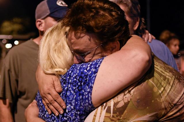 <p>Ann Montgomery (L) and April Higgins, members of First Baptist Church, embrace during a vigil for victims of a mass shooting in Sutherland Springs, Texas, Nov. 5, 2017. (Photo: Mohammad Khursheed/Reuters) </p>