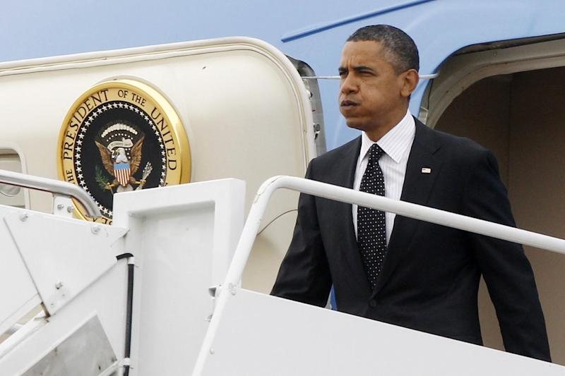 President Barack Obama steps off Air Force One at Andrews Air Force Base, Md. upon his return from Afghanistan, Wednesday, May 2, 2012. (AP Photo/Charles Dharapak)