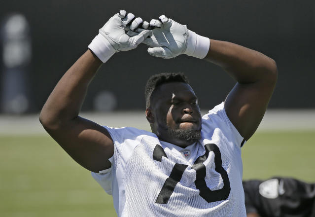Kelechi Osemele says he's in too much pain to play through a torn labrum — the Jets would like him to do otherwise. (AP Photo/Eric Risberg)