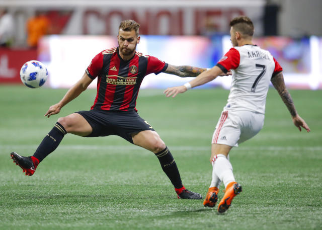 Atlanta United defender Leandro Gonzalez (5) battles against D.C. United forward Paul Arriola (7) in the first half of an MLS soccer game on Sunday, March 11, 2018, in Atlanta. The Atlanta United won the game 3-1. (AP Photo/Todd Kirkland)