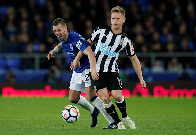 "Soccer Football - Premier League - Everton v Newcastle United - Goodison Park, Liverpool, Britain - April 23, 2018 Everton's Morgan Schneiderlin in action with Newcastle United's Matt Ritchie REUTERS/Andrew Yates EDITORIAL USE ONLY. No use with unauthorized audio, video, data, fixture lists, club/league logos or ""live"" services. Online in-match use limited to 75 images, no video emulation. No use in betting, games or single club/league/player publications. Please contact your account representative for further details."