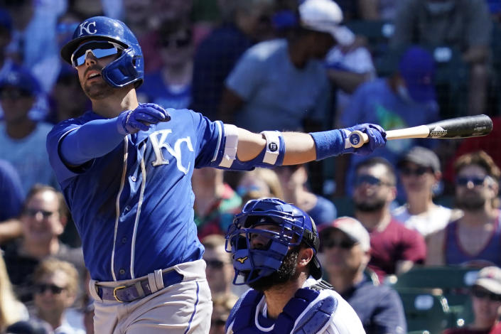 Kansas City Royals' Whit Merrifield watches his sacrifice fly to Chicago Cubs left fielder Ian Happ in the fourth inning of a baseball game Sunday, Aug. 22, 2021, in Chicago. (AP Photo/Nam Y. Huh)
