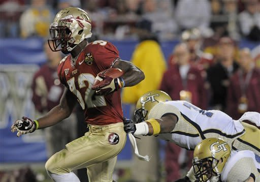 Florida State's James Wilder Jr. (32) runs into the end zone for a touchdown past Georgia Tech's Brandon Watts (11) during the first half of the ACC Championship college football game in Charlotte, N.C., Saturday, Dec. 1, 2012. (AP Photo/Mike McCarn)