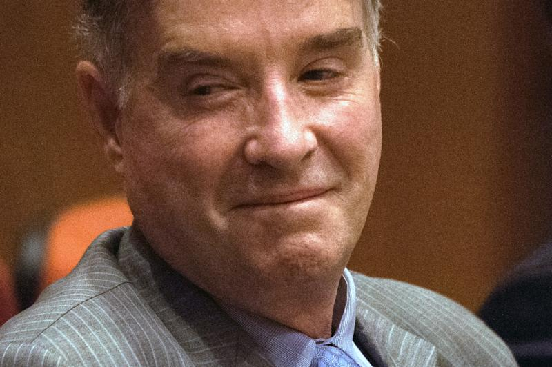 Brazilian businessman Eike Batista, once Brazil's richest man, attends his first day of trial for alleged insider trading in Rio de Janeiro, Brazil, on November 18, 2014. AFP PHOTO / YASUYOSHI CHIBA (Photo credit should read YASUYOSHI CHIBA/AFP/Getty Images)