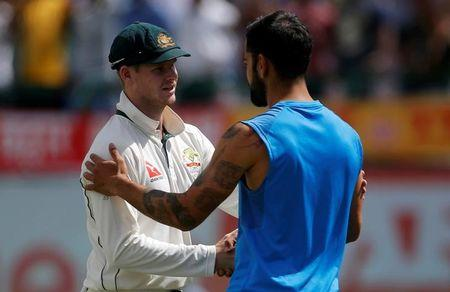 Cricket - India v Australia - Fourth Test cricket match - Himachal Pradesh Cricket Association Stadium, Dharamsala, India - 28/03/17 - India's Virat Kohli (R) shakes hands with Australia's captain Steven Smith after India won the series. REUTERS/Adnan Abidi