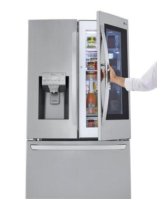 The Craft Ice House features four distinct home settings – a family room, garden patio, whiskey library and game room – with each demonstrating how LG InstaView Refrigerators are the ultimate home entertaining advantage. (PRNewsfoto/LG Electronics USA)