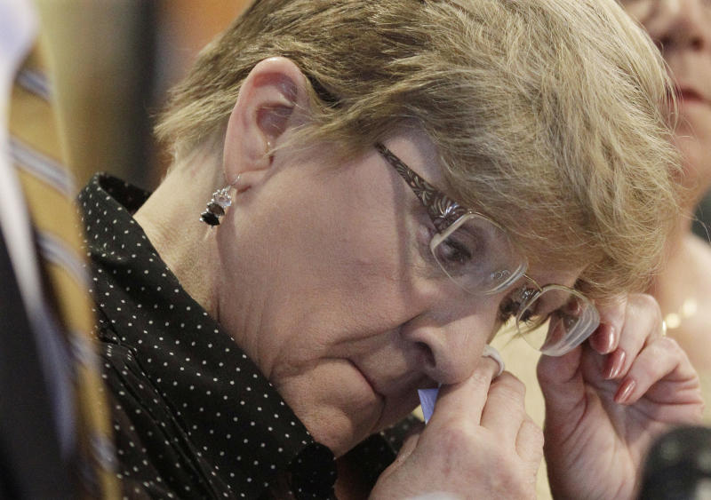 FILE - In this Dec. 3, 2013 file photo, Nanci Koschman, mother of David Koschman, wipes away a tear during a news conference in Chicago, when Richard Vanecko, the nephew of former Chicago Mayor Richard Daley was indicted for involuntary manslaughter in the 2004 death of 21-year-old Koschman outside a Chicago bar. Special prosecutor Dan Webb said in a court filing Thursday Sept. 17, 2013, that no charges will be filed against police or prosecutors after the grand jury review of how they handled investigations into the 2004 death. (AP Photo/M. Spencer Green, File)