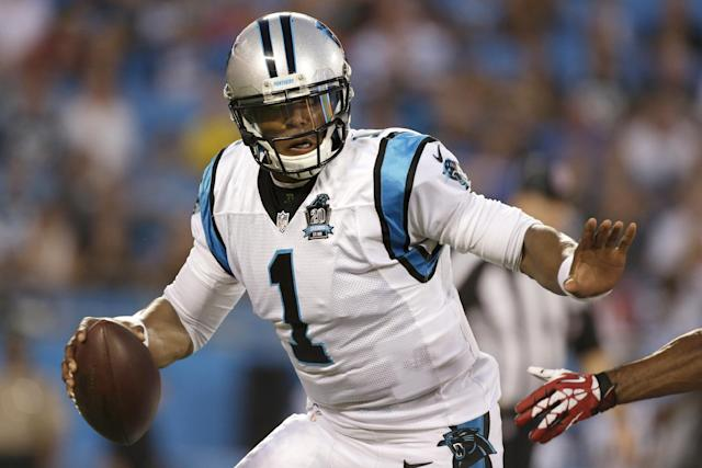 Carolina Panthers' Cam Newton (1) scrambles against the Kansas City Chiefs during the first half of an NFL preseason football game in Charlotte, N.C., Sunday, Aug. 17, 2014. (AP Photo/Bob Leverone)
