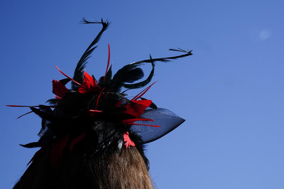 A lady wears a stylish hat before the 147th running of the Kentucky Derby at Churchill Downs, Saturday, May 1, 2021, in Louisville, Ky. (AP Photo/Brynn Anderson)