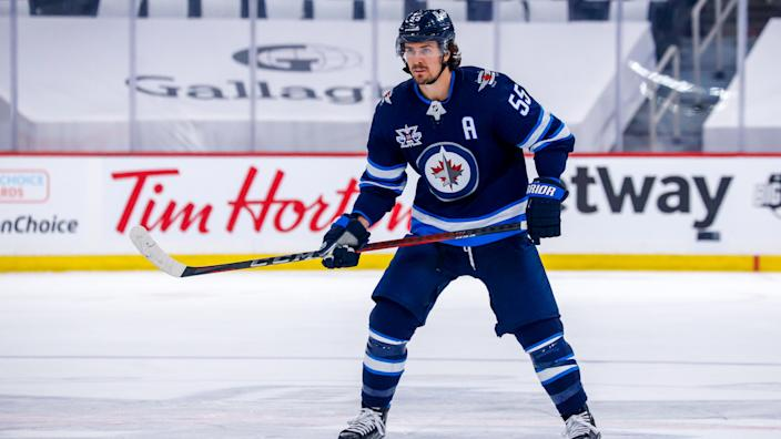 WINNIPEG, MB - JUNE 02: Mark Scheifele #55 of the Winnipeg Jets keeps an eye on the play during first period action against the Montreal Canadiens in Game One of the Second Round of the 2021 Stanley Cup Playoffs at Bell MTS Place on June 02, 2021 in Winnipeg, Manitoba, Canada. (Photo by Darcy Finley/NHLI via Getty Images)
