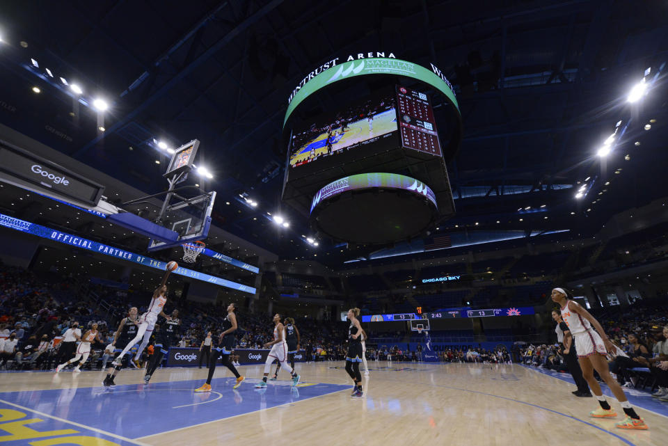 Connecticut Sun's DeWanna Bonner (24) goes up to shoot during the first half of Game 3 of a WNBA semifinal playoff basketball game against the Chicago Sky, Sunday, Oct. 3, 2021, in Chicago. (AP Photo/Paul Beaty)