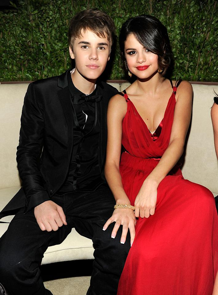 Justin Bieber and Selena Gomez made their first public appearance together as a couple at  the 2011 Vanity Fair Oscar party. The teen titans -- who both donned Dolce & Gabbana -- looked absolutely adorable as they snuggled 'til the early morning hours.