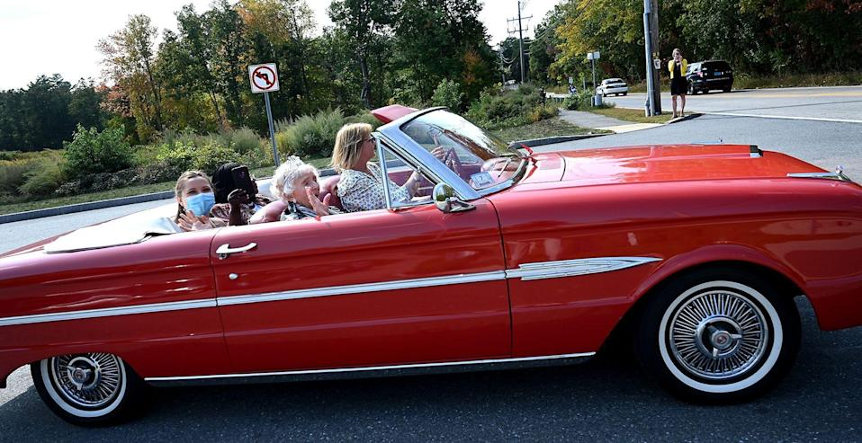One hundred year-old Rita Doucette leaves her Fairview Estates home and turns onto East Main Street in Hopkinton aboard a 1963 Ford Falcon on Friday, Sept. 25.