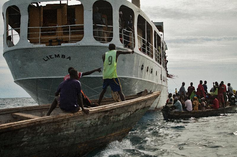 The MV Liemba, a century-old gunship gunship used during the reign of Germany's Kaiser Wilhelm II, is being used to carry Burundian refugees to safety in Tanzania (AFP Photo/chris oke)