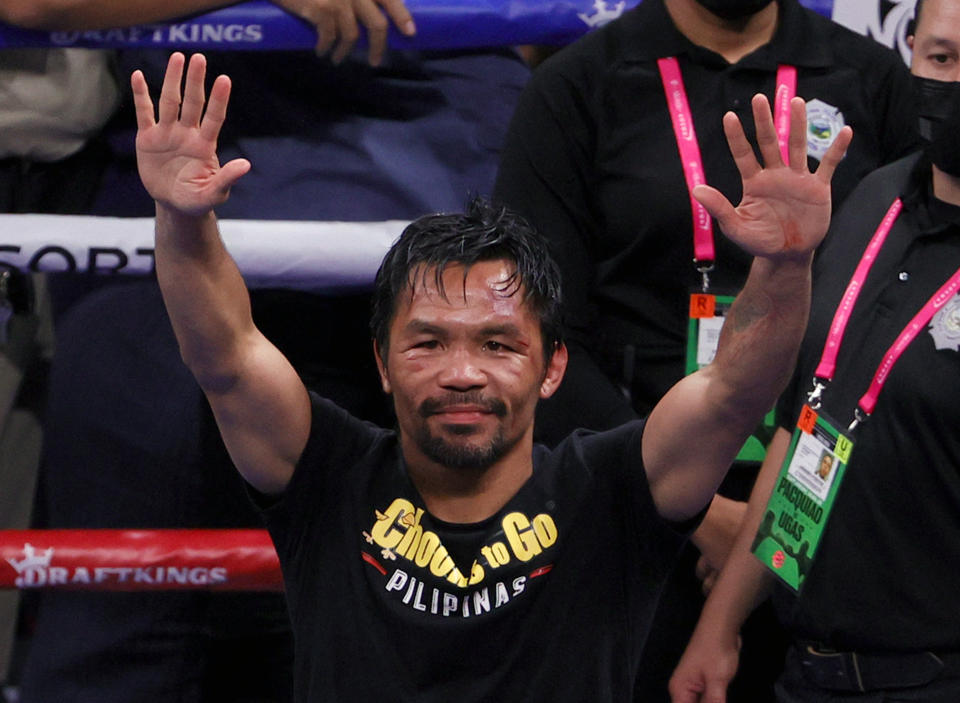 LAS VEGAS, NEVADA - AUGUST 21:  Manny Pacquiao gestures to fans after his WBA welterweight title fight against Yordenis Ugas at T-Mobile Arena on August 21, 2021 in Las Vegas, Nevada. Ugas retained his title by unanimous decision.  (Photo by Ethan Miller/Getty Images)
