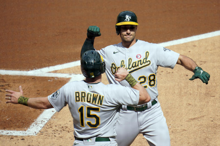 Oakland Athletics' Matt Olson (28) celebrates his two-run home run off Minnesota Twins' pitcher Jose Berrios with Seth Brown (15) in the first inning of a baseball game, Saturday, May 15, 2021, in Minneapolis. (AP Photo/Jim Mone)