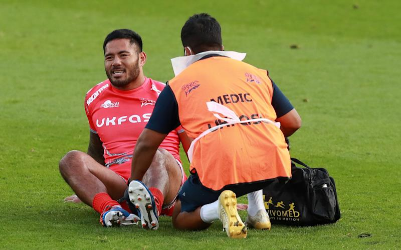 Manu Tuilagi of Sale Sharks receives attention to an injured left leg and is replaced during the Gallagher Premiership Rugby match between Northampton Saints and Sale Sharks - Getty Images