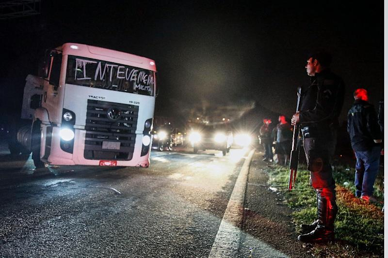 Truckers clear some roads in Brazil, but protests continue
