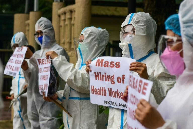 Health workers have been staging protests outside hospitals to demand the hiring of more staff (AFP/Maria Tan)