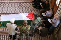 Mourners stand near the coffin of Ahmed Jibril, founder of pro-Syrian Palestinian guerrilla faction during his funeral at a mosque in Damascus