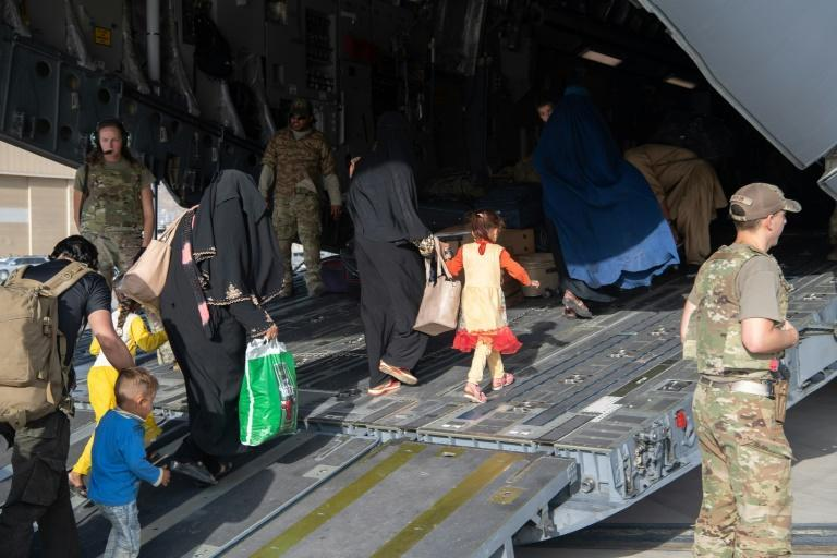 Refugees from Afghanistan board a US Air Force transport at Kabul airport (AFP/Donald R. ALLEN)