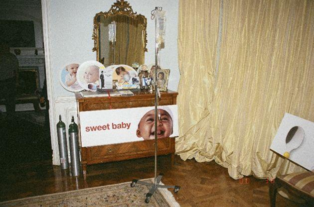 Michael Jackson's shrine of baby photos in the room. This image was shown during the lawsuit between Katherine Jackson and concert promoters AEG Live in 2013. (Photo: LAPD)