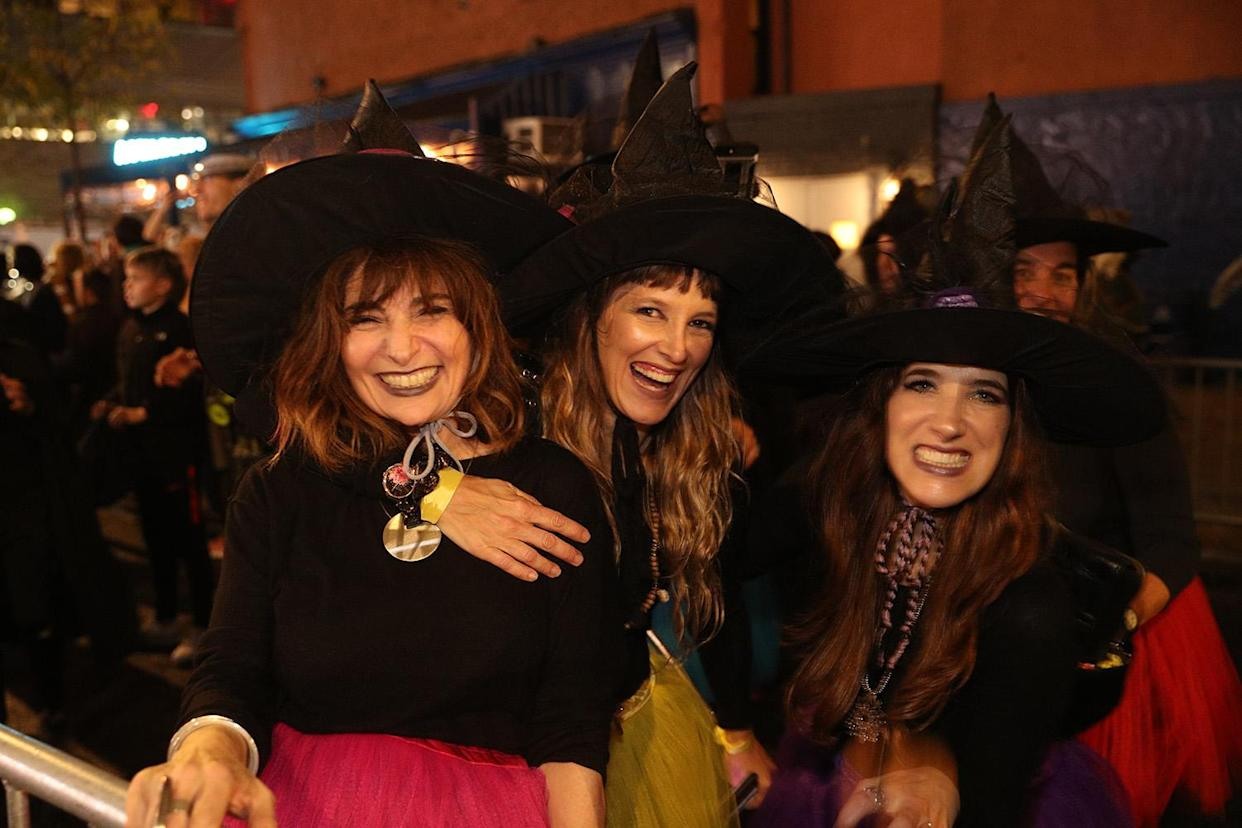 Women dressed as witches participate in the annual Village Halloween Parade in New York City. (Photo: Gordon Donovan/Yahoo News)