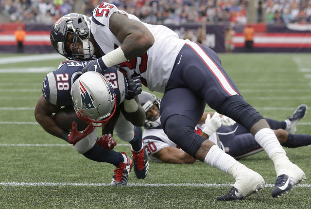 New England Patriots running back James White (28) scores a touchdown past Houston Texans linebacker Benardrick McKinney (55) during the first half of an NFL football game, Sunday, Sept. 9, 2018, in Foxborough, Mass. (AP Photo/Steven Senne)